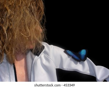 Black and blue veiled butterfly close up on a woman' shoulder