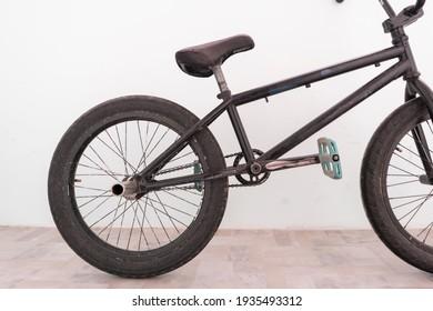 black bmx bike standing near the wall, extreme sports equipment