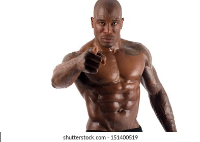 Black bodybuilder pointing to you and asking you to train harder. Trainer motivating to train. Strong man with perfect abs, shoulders,biceps, triceps and chest. Isolated on white background