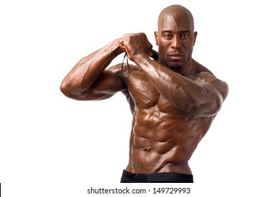 Black bodybuilder training with a bendy bar.  Strong man with perfect abs, pecs shoulders,biceps, triceps. Isolated on white background