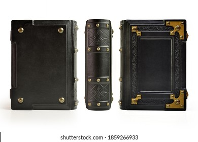 Black book with embossed the frame and bras corners with metal pins. Captured from in stand up position from three sides