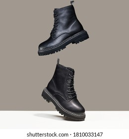 Black boots in the air. fashion shoes still life. stylish photo in the studio - Shutterstock ID 1810033147