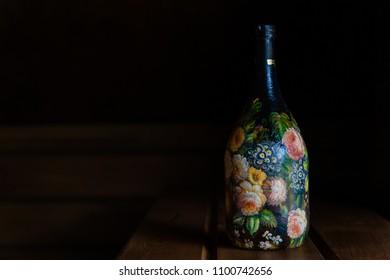 Black bottle in decoupage technique