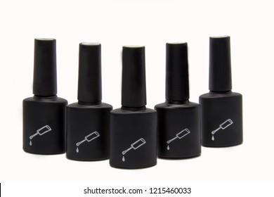 Black bottle of gel nail polish isolated on white background