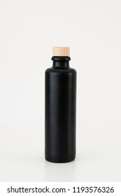 black bottle on white background