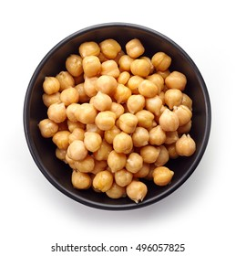 Black bowl of preserved chickpeas isolated on white background, top view