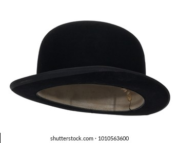 Black bowler hat isolated on white background.  Almost straight side view. Tilted up a little, showing the interior leather band.