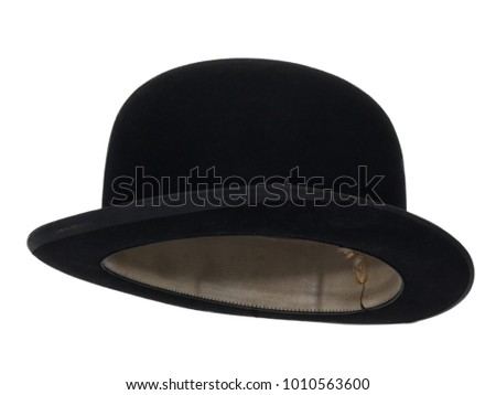 bdd9840ca6f Black bowler hat isolated on white background. Almost straight side view.  Tilted up a