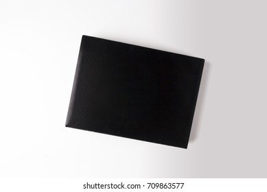 black box on gray background with