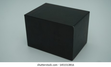 Black box on white background for small gifts