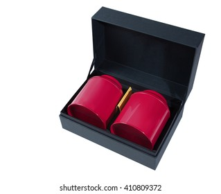 Black box open with two red cans inside isolated on white