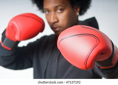 Black Boxer with red boxing gloves