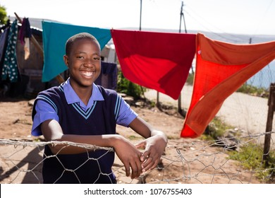 Black boy with a beautiful smile on his face standing in  the township.