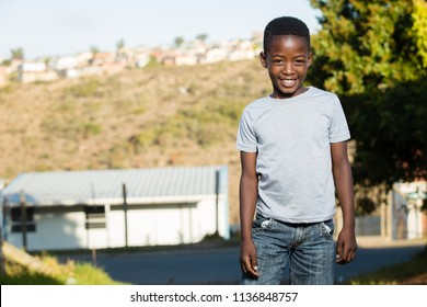 Black boy with a beautiful smile while in a township