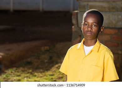 Black boy with a sad look on his face while looking straight into the camera