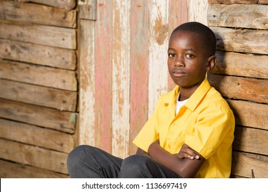 Black boy with a serious expression on his face while looking straight into the camera