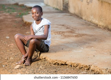 black boy with a smile on his face while sitting down
