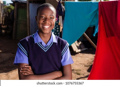 Black boy with a stunning smile in a township.