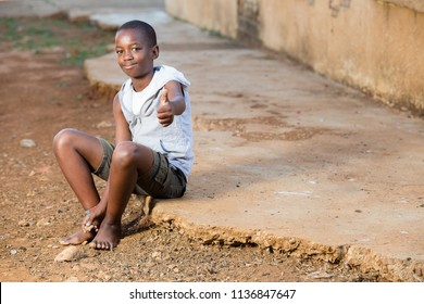 Black boy with a thumbs up while looking into the camera
