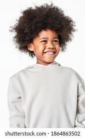 Black boy wearing gray sweatshirt in studio