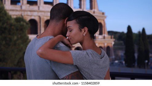 Black Boyfriend And Girlfriend In Rome Chatting Front Of The Colosseum