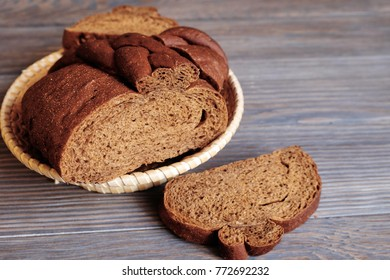 Black bread on a wooden texture