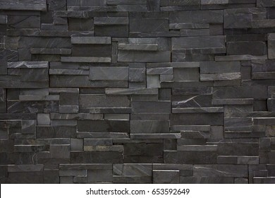 Black brick wall for background.