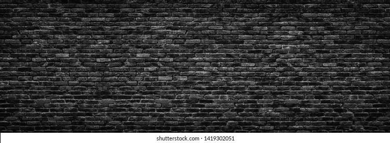 black brick wall background. dark stone texture