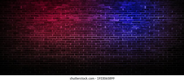 Black brick wall background rough concrete with neon lights and glowing lights. Lighting effect pink and blue on empty brick wall background