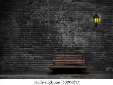 Black Brick wall design with lamp and Wooden old bench