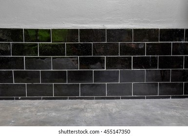 black brick wall with the grey grunge cement floor