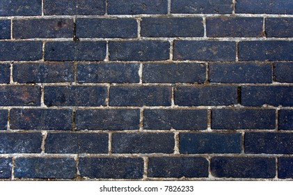 A black brick wall, suitable as a background or texture