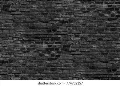 black brick wall texture grunge background, seamless background