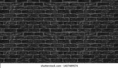 Black brick wall texture. Old rough brickwork. Dark grunge background