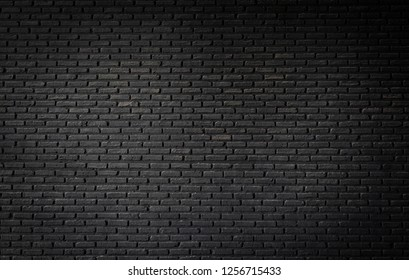 Black brick wall texture, brick surface background. Vintage floor wallpaper.