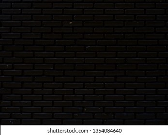 The black brick wall is used as a background.