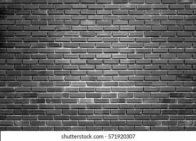 Black brick walls backdrop style dark tones.Background wallpaper