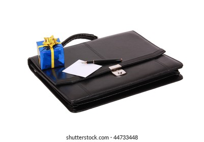 Black briefcase and blue gift isolated on white background