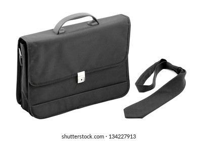 Black briefcase laptop and documents with tie.