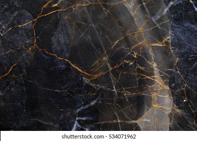 Black and brown patterned natural of dark marble (Gold Russia) texture background.