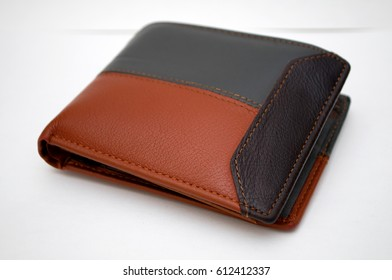 black and brown wallet on a white background