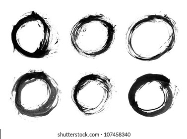 Black brush stroke in the form of a circle. Drawing created in ink sketch handmade technique. Isolated shapes on white background.