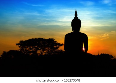 Black buddha silhouette with two tone sky