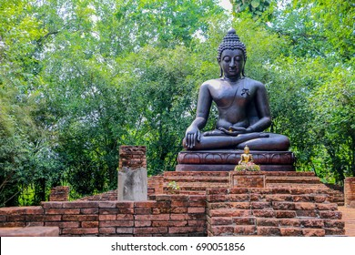 The black Buddha statue seated art religion thailand culture.
