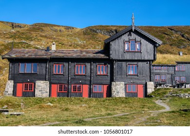 Black building on the rural hill in Norway, it's dark color attracts the heat, Scandinavia