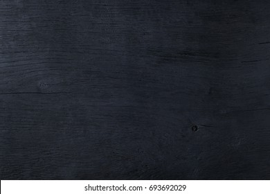 Black burned wooden abstract background copy space