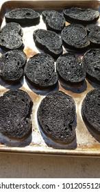 Black Burnt Toast on cookie sheet
