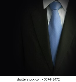 Black business suit with tie