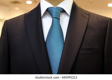 Black business suit with a white shirt and with a blue tie in drawing