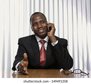 A black businessman working at his desk